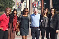 Human Rights Clinic students Daniella Peterson, James Slater, and Charlotte Cassel, together with Professor Caroline Bettinger-Lopez, Marleine Bastien from Haitian Women of Miami (FANM), and Meena Jagannath from the Community Justice Project of Florida Legal Services, stand in front of the UN Palais des Nations, Geneva.