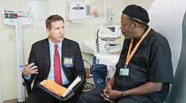 Photo: Miami Law 3L Noel Pace, left, and a patient, right