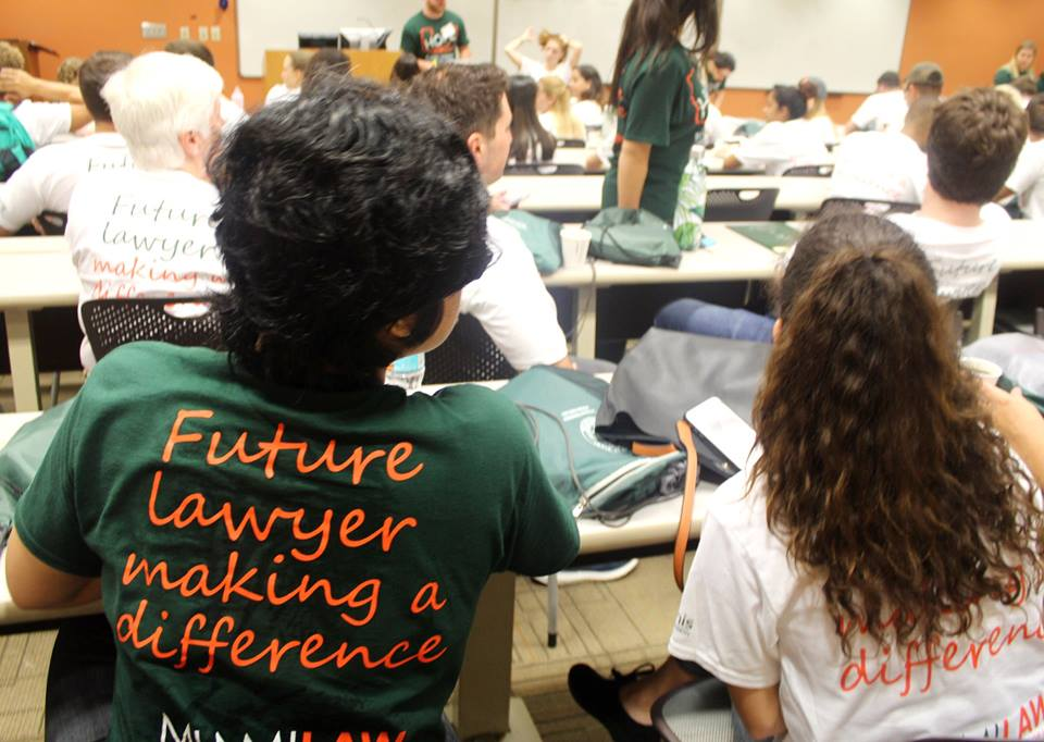 "View of back of student with shirt saying ""Future Lawyer Making a Difference"""