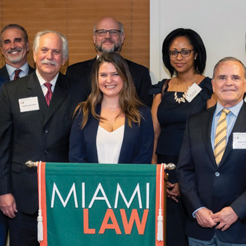 Gianna Fina, 3L, with members of Holland & Knight and Lonnie Rose, Director of Litigation Skills Program