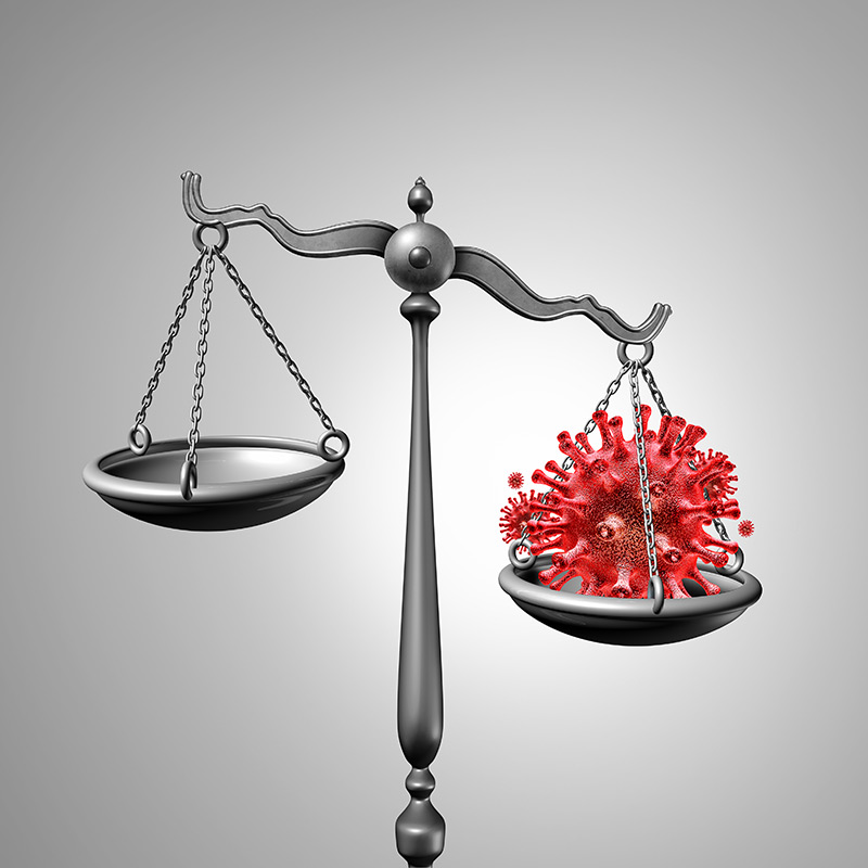 Scales of justice with virus cell