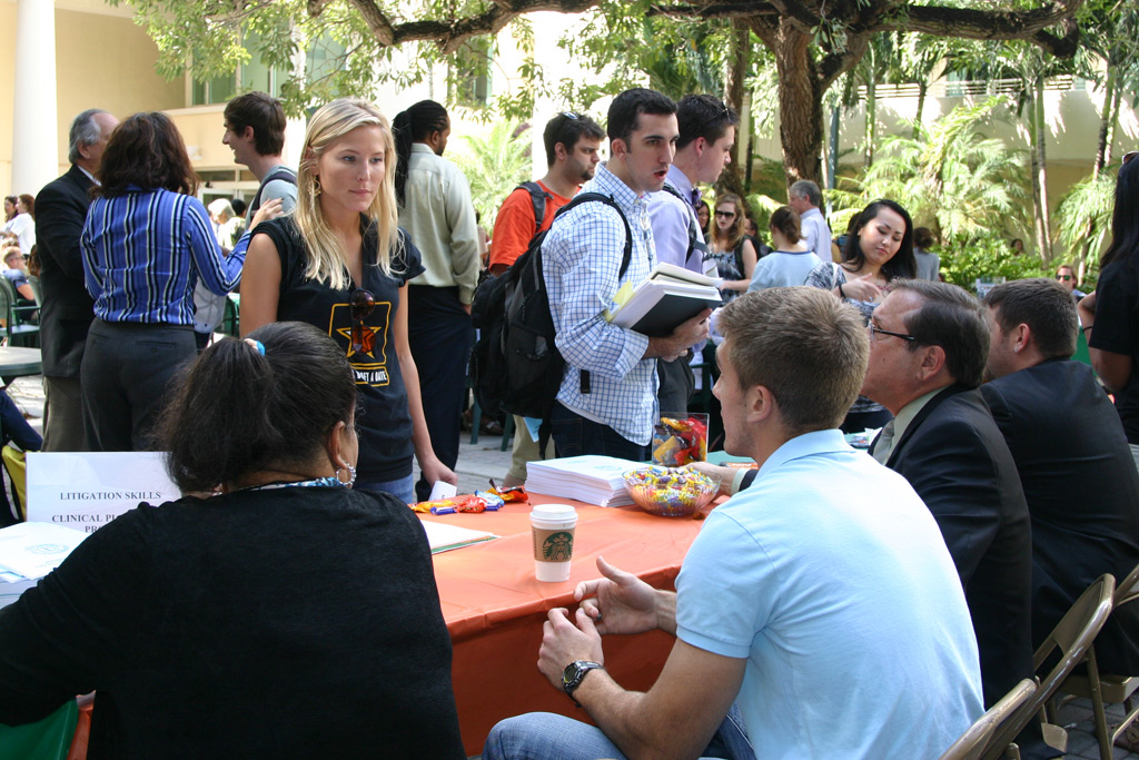 Students at the Public Interest Fair on the Bricks at Miami Law