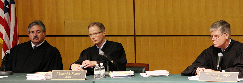 Justices Ivan F. Fernandez, Richard J. Suarez and Thomas Logue of the Third District Court of Appeal. (Photo: Miami Law)