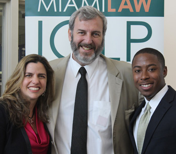Jessica Carvalho Morris, Professor Claudio Finkelstein, and Julien Apollon, 3L, International Law Society (Photo: Miami Law)
