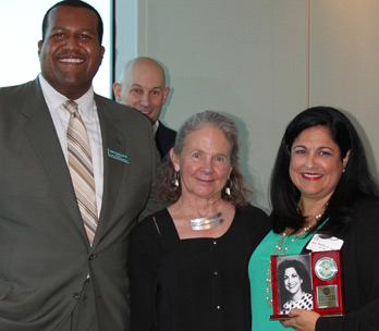 Judge Bertila A. Soto receiving the Alumni Achievement Award from Jaret Davis and Dean White (Photo: Miami Law)