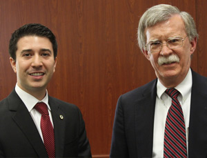 Javier Enriquez, president of the Federalist Society, and Ambassador John Bolton (Photo: Miami Law)