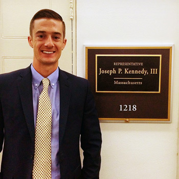 Brendan Corrigan in front of U.S. Representative Kennedy's office.
