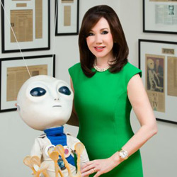 """Laurie Silvers posing with her """"little alien friend"""" from the SyFy Channel."""