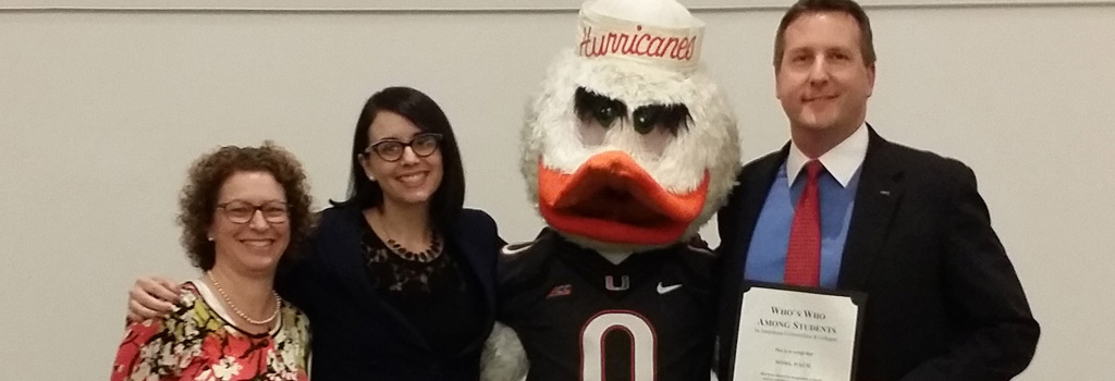 Dean of Students Janet Stearns, Anna Vino, and Noel Pace with Sebastian the Ibis.