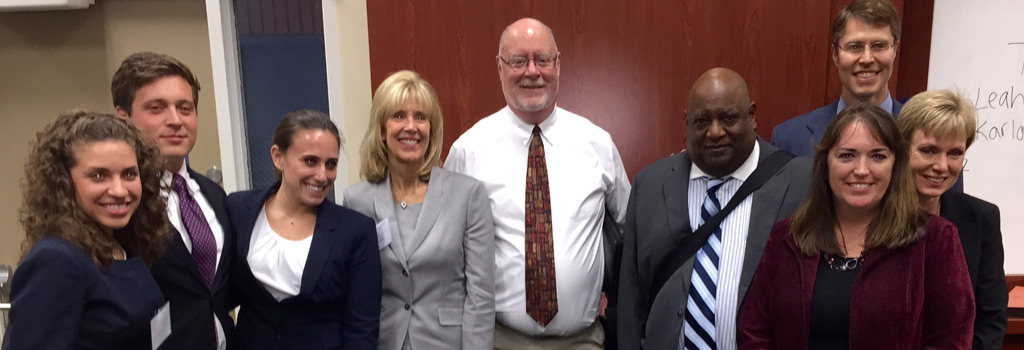 (left to right) Karla Albite, 3L; Jimmy Czodli, 2L; Leah Aaronson, 3L; Professor Patricia Redmond; Judge John K Olson; Judge C. Ray Mullins; Eric Brundstad; Judge Laurel M. Isicoff; Maria Chavez-Ruark