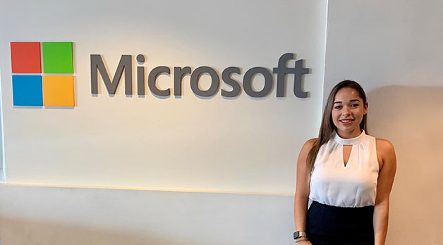 Talia Boiangin in front of Microsoft sign
