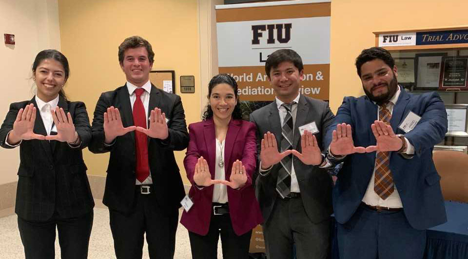 Students throwing up the U at the Int'l Commercial Arbitration Pre-Moot