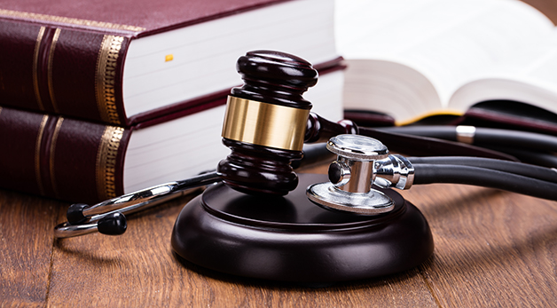 law books with stethoscope