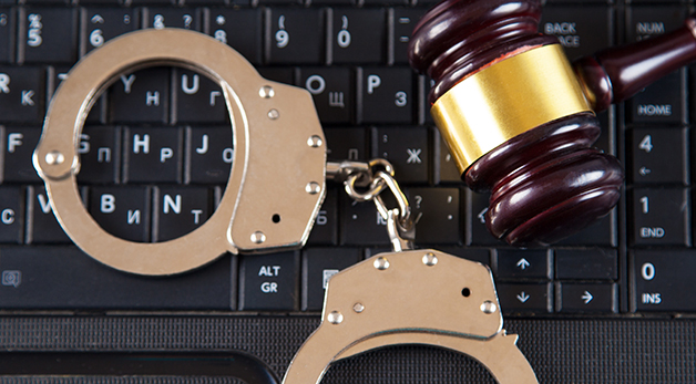 handcuffs on top of a computer keyboard