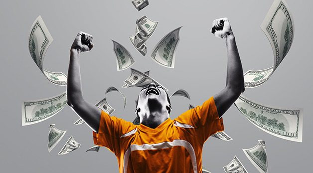 soccer player surrounded by money